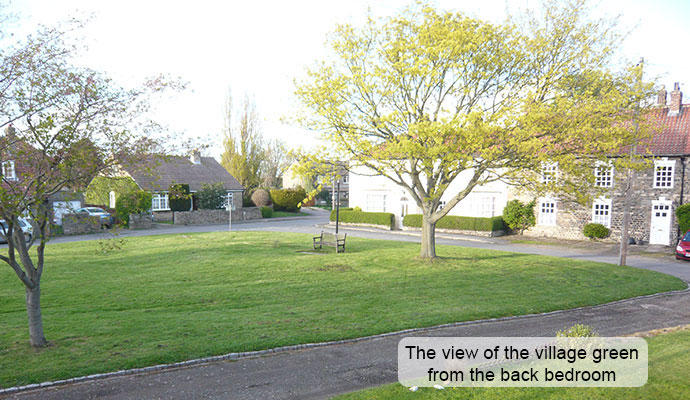 The view of the village green from the back bedroom